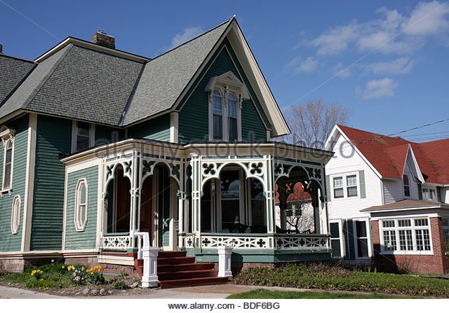 Marquette Michigan Upper Peninsula U.P. UP Lake Superior Ridge Street Victorian style house home porch gingerbread - Stock Image