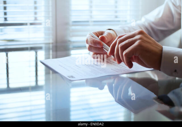 business man before signing contract - Stock-Bilder