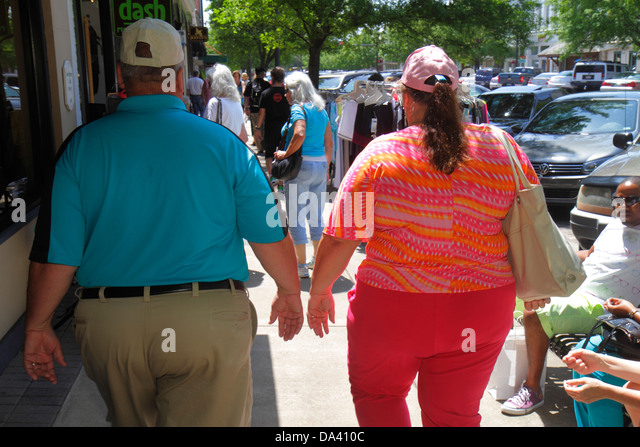 Georgia Thomasville downtown South Broad Street man woman couple overweight fat - Stock Image
