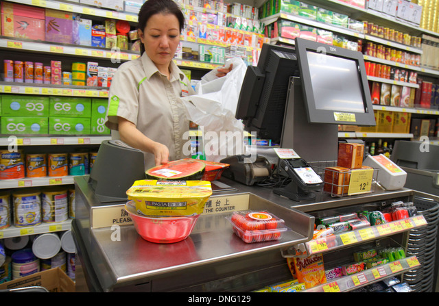 Hong Kong China Kowloon Island North Point Java Road Wellcome Supermarket grocery store food sale display shelves - Stock Image