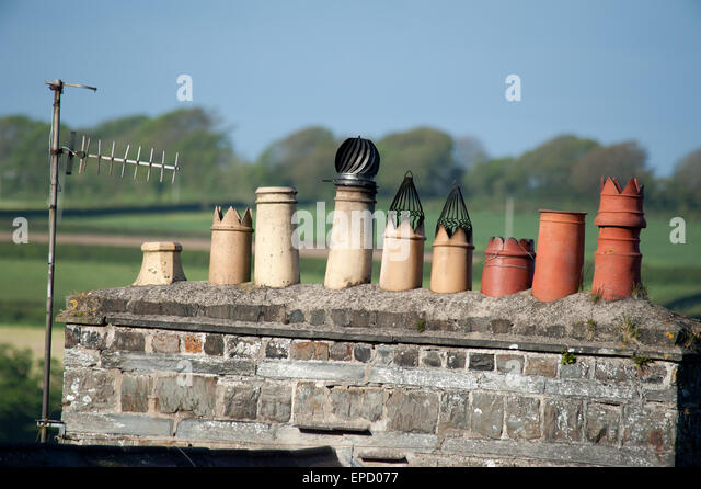 Row of chimney pots on stone house, St Dogmaels Wales - Stock Image