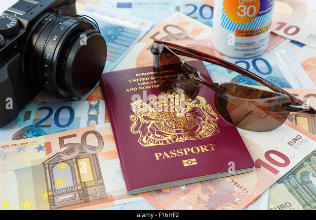 Things for foreign travel with passport currency camera suncream and sunglasses for travelling to Eurozone countries - Stock-Bilder