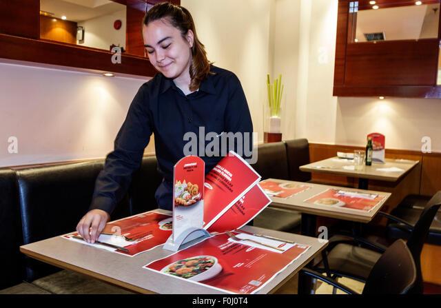 Madrid Spain Europe Spanish Salamanca Recoletos Calle Alcala Vips restaurant dining casual franchise inside waitress - Stock Image