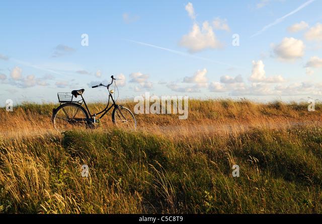 Bicycle on a coastal boardwalk against a beautiful blue sky,  North Sea Islands of Germany, Wangerooge. - Stock Image