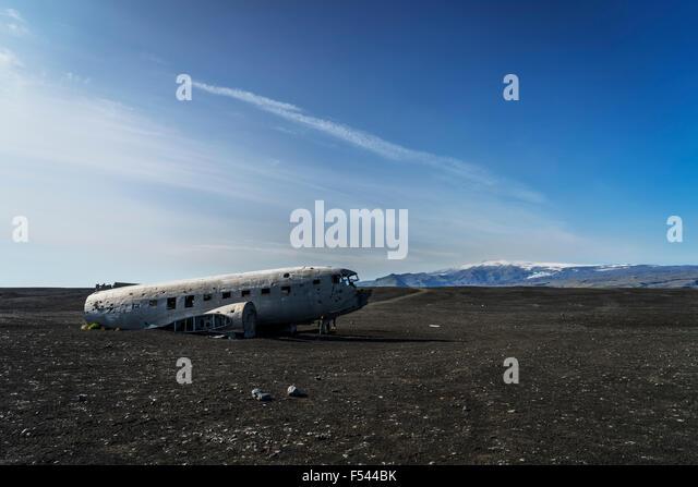 Wreckage from an old airplane crash on Solheimasandur black sand beach, South Coast Iceland - Stock Image