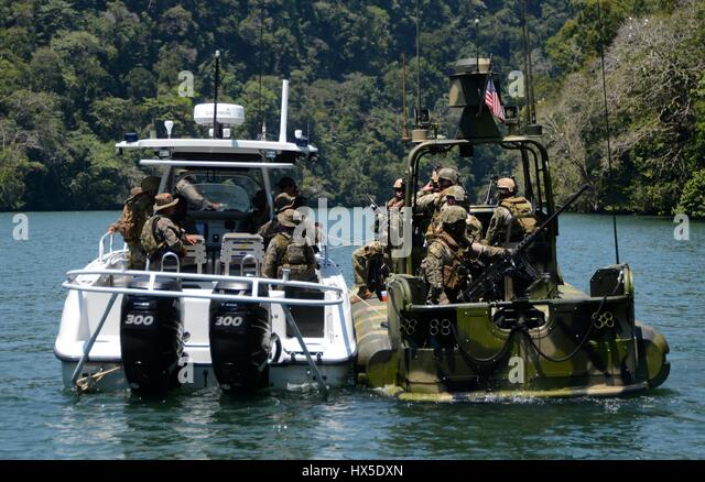 U.S. Navy Sailors and Guatemalan Navy Special Forces perform a hip tow maneuver during Southern Partnership Station - Stock Image