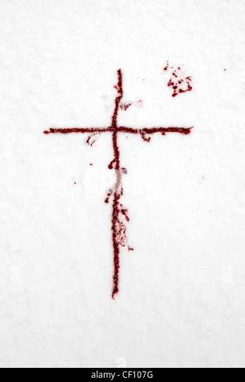 a cross of blood in the snow - Stock Image