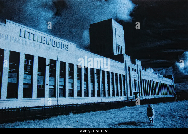 Liverpool Pools Building 1995 with dog and man. Image toned blue - Stock Image