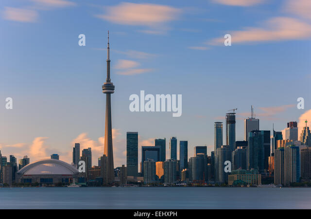 Toronto CN Tower at sunset with a long exposure, taken from the Toronto Islands. - Stock Image