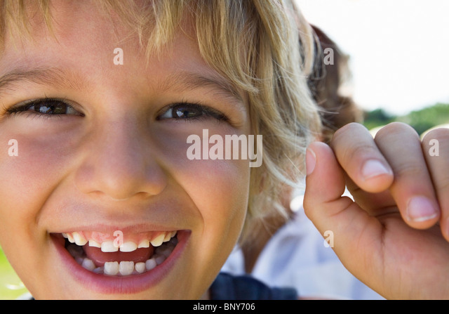 Extreme close-up of a young boy smiling - Stock Image