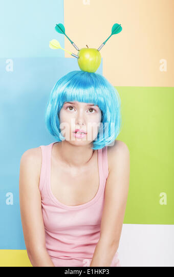 Stylized Woman with Apple on her Blue Haired Head. Series of Photos - Stock Image