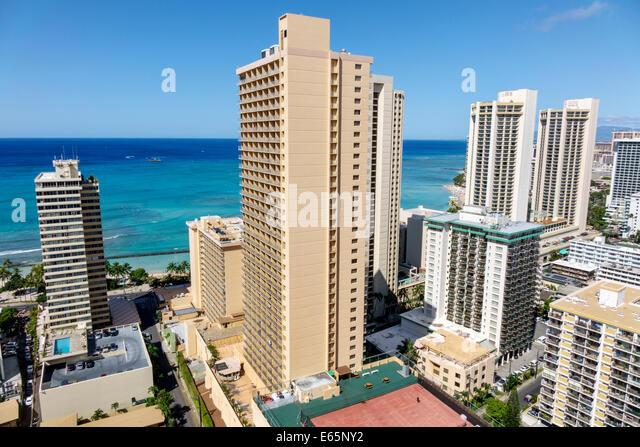Hawaii Hawaiian Honolulu Waikiki Beach Pacific Ocean resort high rise building hotels condominium buildings - Stock Image