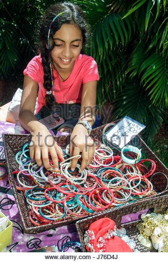 Miami Beach Florida South Pointe Elementary School PTA Green Market Fundraiser booth vendor Asian girl student for - Stock Image