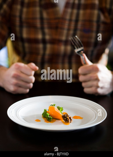 Person with small amount of food - Stock Image