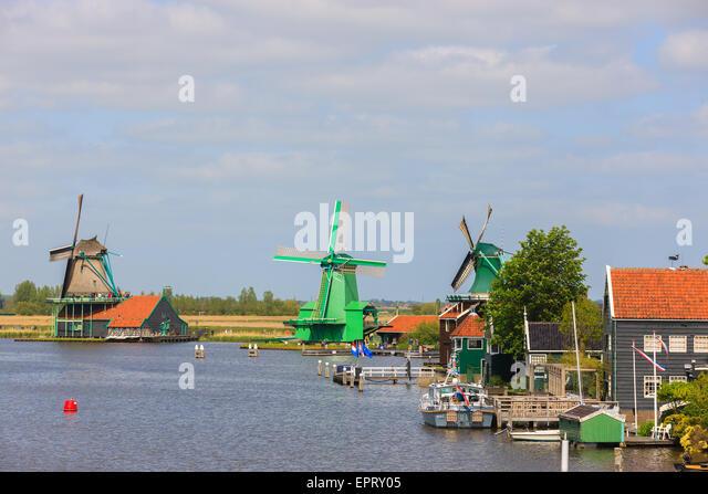At the Zaanse Schans, Dutch windmills along the river De Zaan north of Amsterdam, the Netherlands. - Stock Image