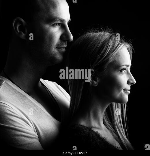 Loving couple, black and white profile picture - Stock-Bilder