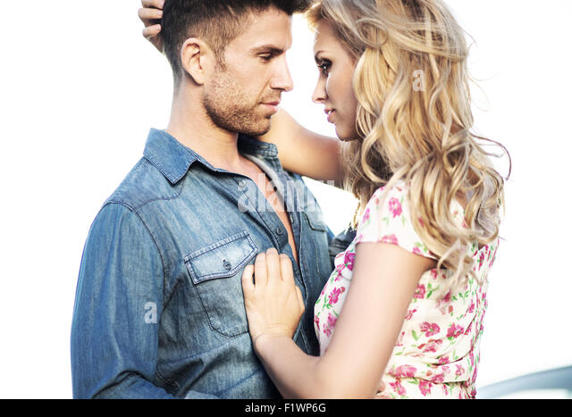 Romantic scene of the kissing marriage couple - Stock Image