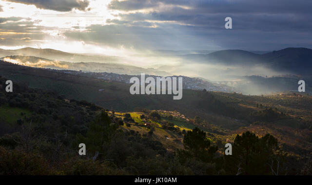 Overview of the Guadalupe town during a foggy sunrise, Caceres, Spain - Stock Image