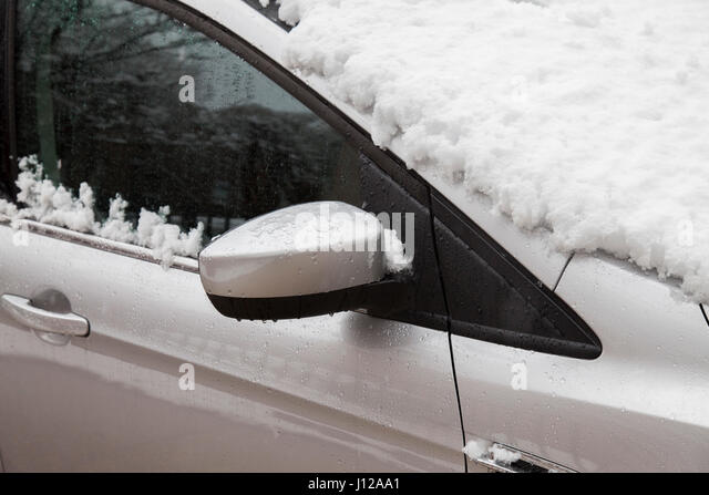 Silver car covered with snow, Winter storm - Stock Image