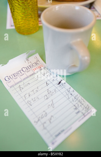 An inside view of an American Diner and the check for the breakfast meal. - Stock-Bilder