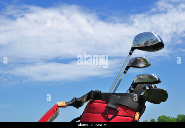 Golf Clubs in a Red Bag, putter, irons, driver, 3 wood and hybrid - Stock Image