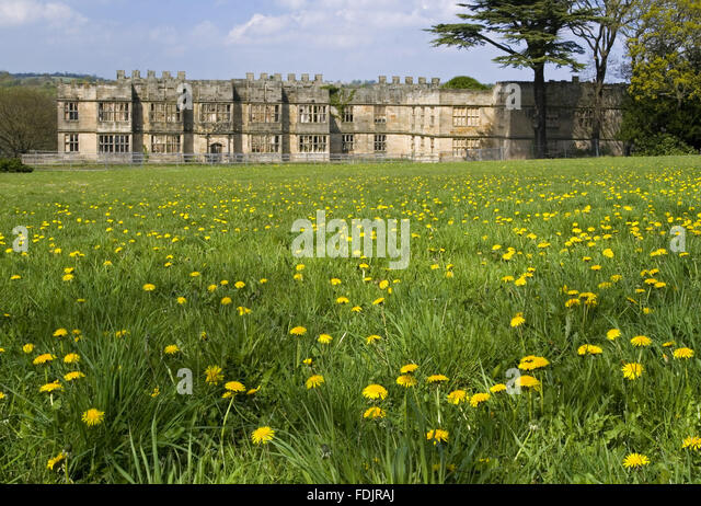 View across a wildflower meadow towards the Hall built between 1603 and 1620, with alterations in both the 18th - Stock-Bilder