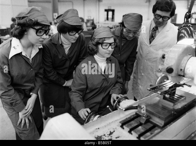 Instructor Anthony Rollins with trainees at the Lucas Industries factory in Birmingham. The girls are, left to right, - Stock Image