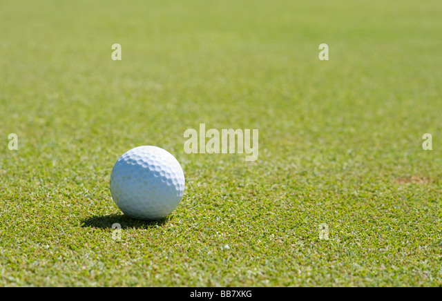 Golf ball on the putting green - Stock Image