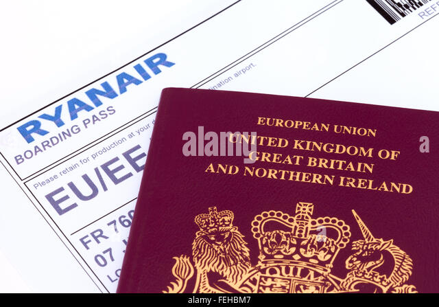 UK passport and Ryanair boarding pass - concept - travel, foreign travel, flying - Stock-Bilder