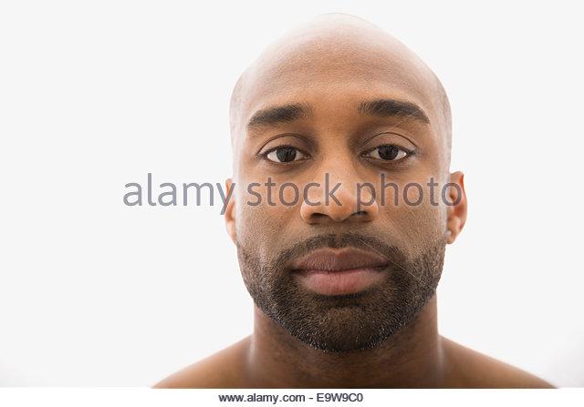 Close up portrait of serious man with beard - Stock-Bilder