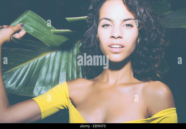 Young Woman Holding Palm Leaf - Stock Image