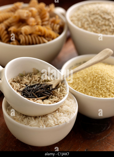 Wild rice Basmati pasta in measuring cups - Stock Image
