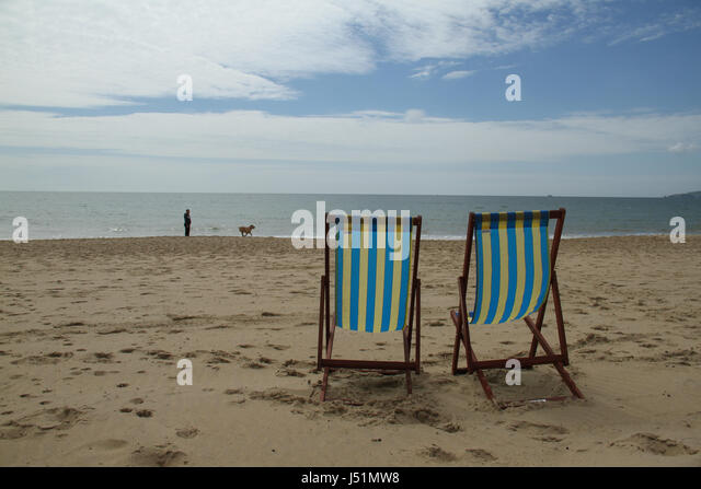 Bournemouth, UK -  13 May: Deck chairs on the sandy Bournemouth beach. General view of the seaside town of Bournemouth - Stock Image