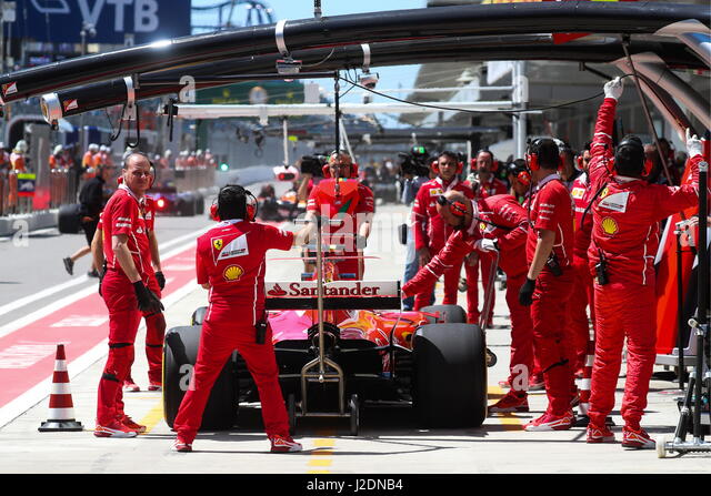 Sochi, Russia. 28th Apr, 2017. Scuderia Ferrari F1 team mechanics seen during a practice session ahead of the 2017 - Stock Image