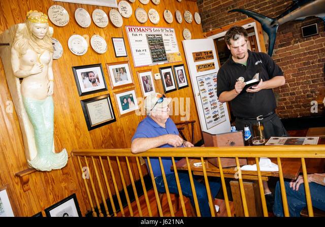 Charleston South Carolina National Historic Landmark Historic District Meeting Street Hyman's Seafood restaurant - Stock Image
