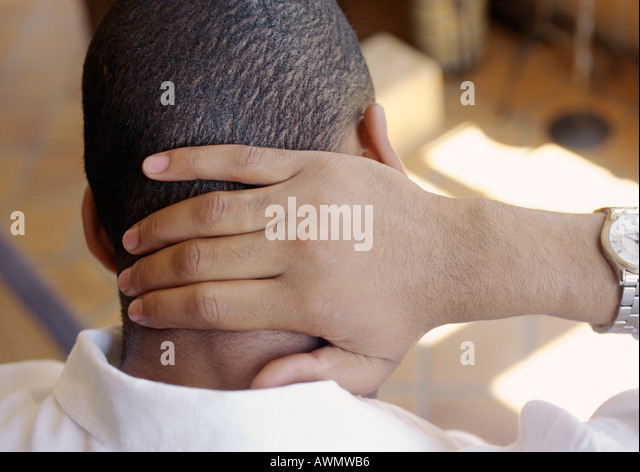 Man, hand on back of neck, rear view, close-up - Stock Image
