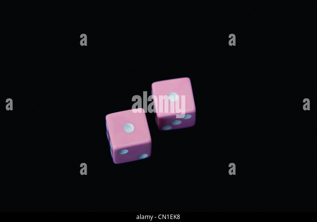 Pink Dice with Snake Eyes - Stock Image
