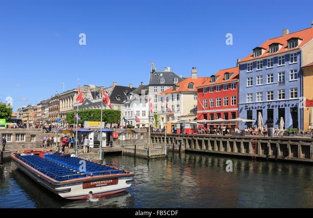 Canal tour boat in Nyhavn, Copenhagen, Zealand, Denmark, Scandinavia, Europe - Stock Image