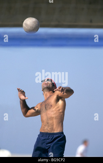 Man playing beach volleyball - Stock Image