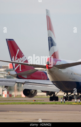 Tailplanes of Virgin Atlantic Aiways and British Airways - Stock Image