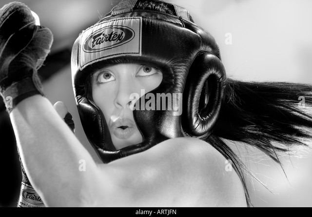 Female boxer during workout at the gym - Stock Image