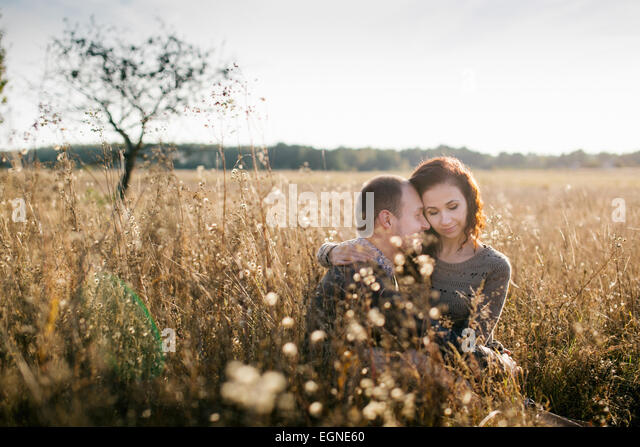 Image of a young couple enjoying their time together at autumn sunset - Stock-Bilder
