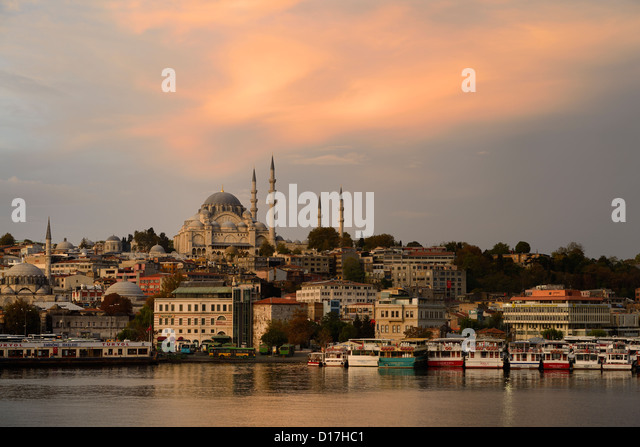 Rustem Pasha and Suleymaniye Mosques with golden sunrise on the waters of the Golden Horn Istanbul Turkey - Stock Image