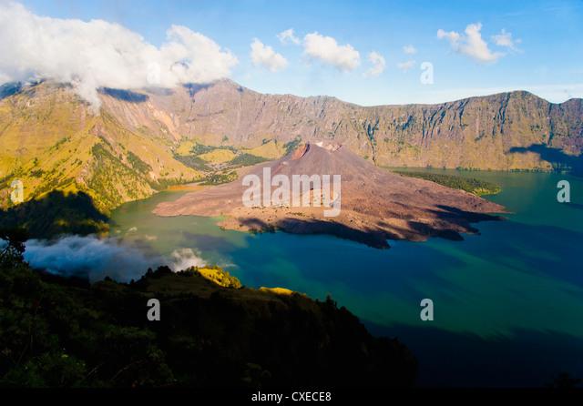 Mount Rinjani caldera, Segara Anak lake and the active volcano, Gunung Baru, Lombok, Indonesia, Southeast Asia, - Stock Image