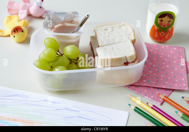 Close up of packed lunch at school - Stock Image
