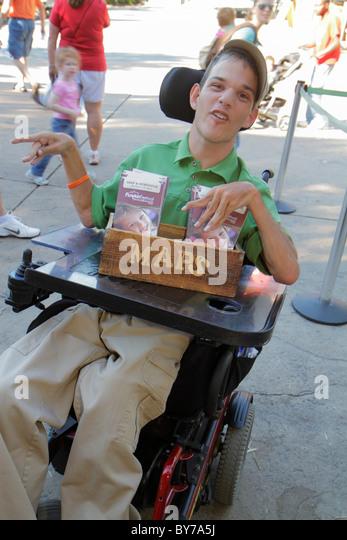 Atlanta Georgia Stone Mountain Park disabled paraplegic male teen electric wheelchair ADA. job map schdule information - Stock Image