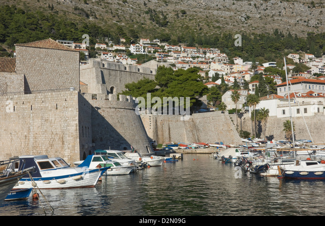 Boats moored in the shelter of the walls of the Old City, Dubrovnik, UNESCO World Heritage Site, Croatia, Europe - Stock Image