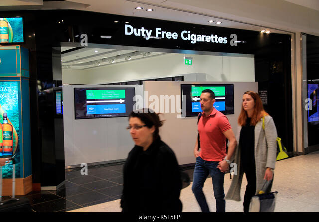 Screened off shop for duty free cigarettes, Terminal Five, Heathrow airport, London, England, UK - Stock Image