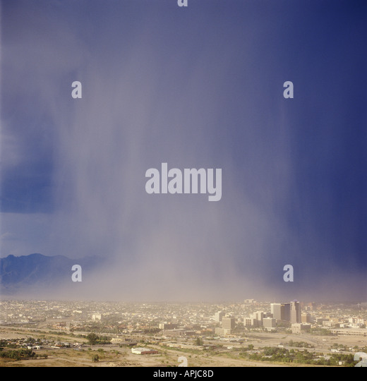 A summer monsoon storm produces a deluge of rain water onto the city of Tucson Arizona USA as seen from atop A Mountain. - Stock Image