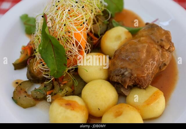 A traditional Polish meal of meat, vegetables and potatoes at a restaurant on the Old Town Market Square in Warsaw, - Stock Image
